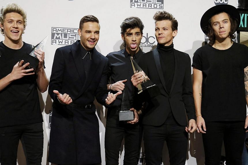 One Direction poses backstage with their awards during the 42nd American Music Awards in Los Angeles, California on Nov 23, 2014. -- PHOTO: REUTERS