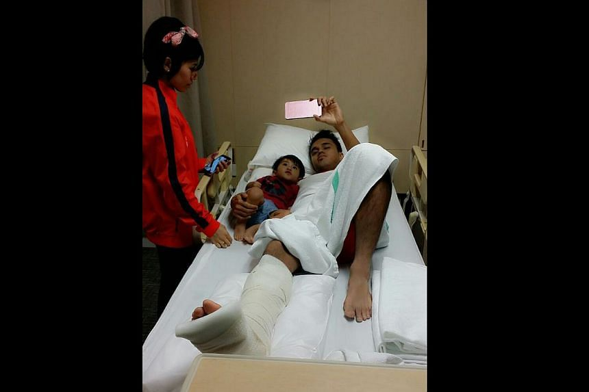 (Above) Singapore midfielder Shahdan Sulaiman, recovering from a broken fibula, resting in hospital with his wife Suzi Elya and son Shaqeel. The injury will keep the player out for six months. (Left) The horrendous sight of Shahdan's (front) ankle be