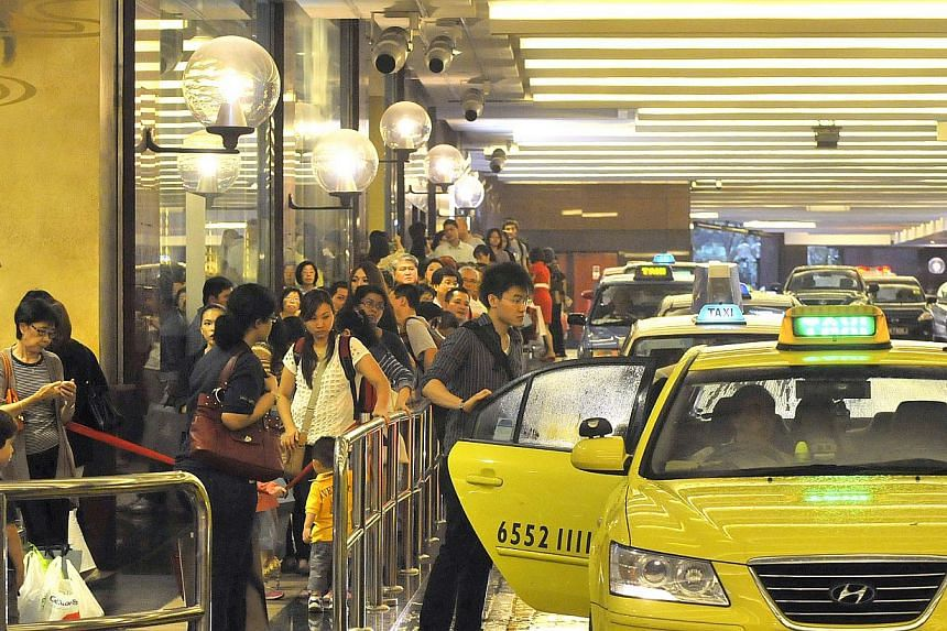 There are 1,400 more cabs available now during the peak hour grind than there were two years ago. But many commuters have yet to feel the difference.