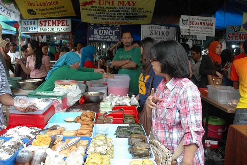 Under a government austerity drive, local snacks should be served at official gatherings and the number of guests invited to high-ranking bureaucrats' parties should be limited to 400, said a minister. -- ST FILE PHOTO