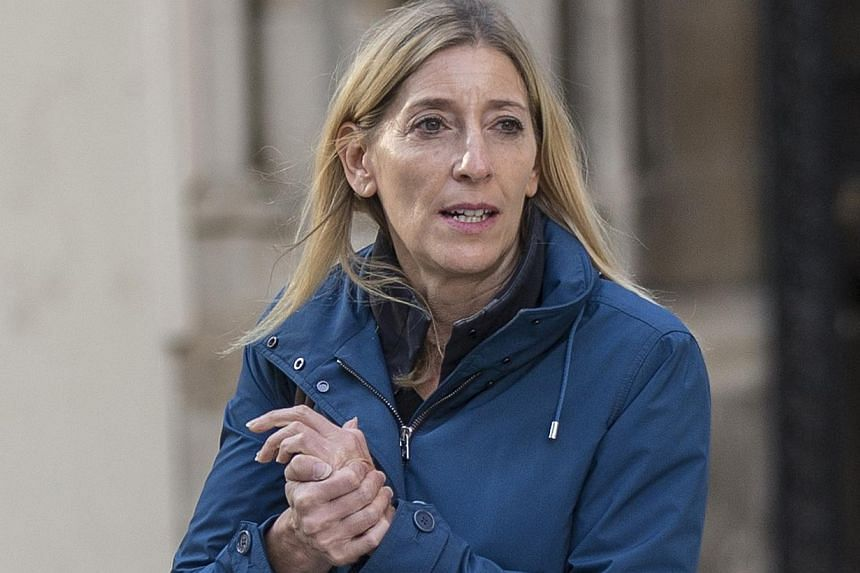 Jamie Cooper, the estranged wife of billionaire hedge fund manager Chris Hohn, leaves the High Court after a divorce hearing, in central London in this Oct 10, 2014 file photo. -- PHOTO: REUTERS