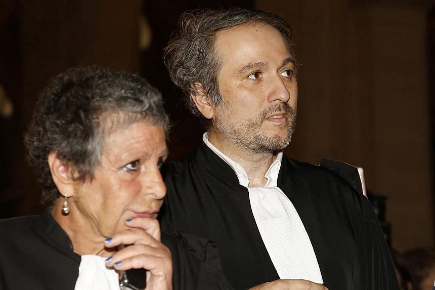 Francoise Cotta (left), lawyer of the driver Eric Robic, and Regis Meliodon, lawyer of the passenger Claude Khayet, arrive for the start of the trial at the Paris courthouse on Nov 27, 2014.The trial was suspended on Thursday after Meliodon&nbs
