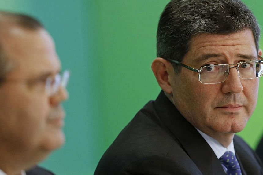 Brazil's incoming finance minister, banker Joaquim Levy, attends a news conference announcing the Brazilian government's new economic team, at the Planalto Palace in Brasilia Nov 27, 2014. -- PHOTO: REUTERS