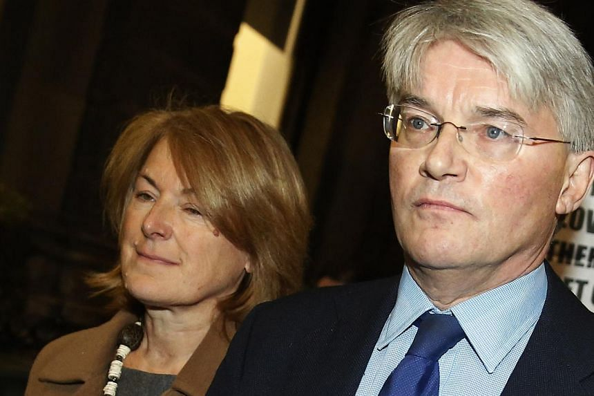 Andrew Mitchell, Britain's former Conservative Party chief whip, leaves the Royal Courts of Justice with wife Sharon Bennett in London, Nov 27, 2014. Mitchell lost a libel case on Thursday over a newspaper article which said he had insultingly referr