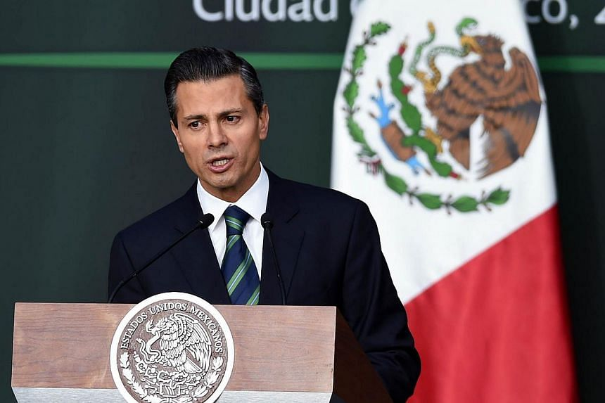 Mexican President Enrique Pena Nieto talks during his message about the new programme against corruption and new order in the police at the Palacio Nacional in Mexico City, on Nov 27, 2014. -- PHOTO: AFP
