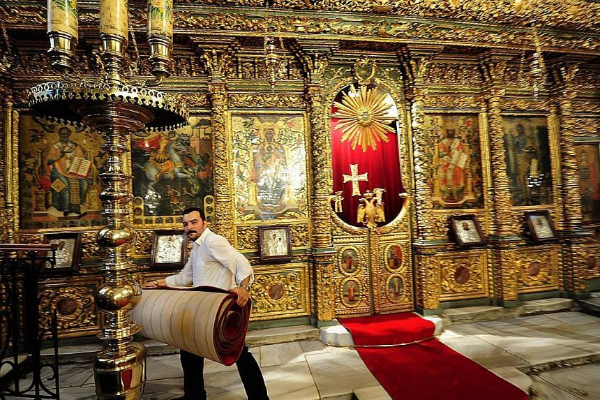 Staff of St. George Church in Fener Patriarchate on Nov 27, 2014, preparing for Pope Francis' visit to Istanbul. He will be in Turkey from Nov 28 to 30. -- PHOTO: AFP