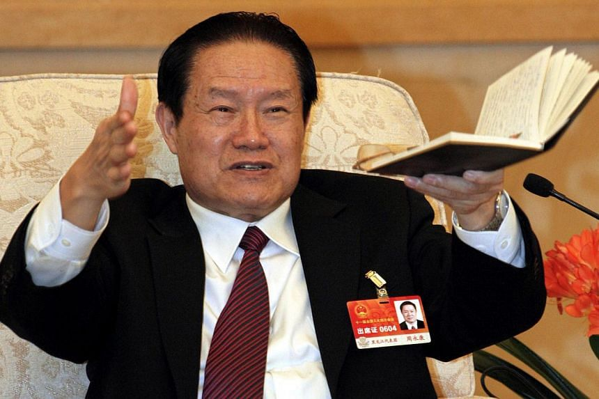 An investigation into China's former domestic security chief Zhou Yongkang (above, in a 2011 file photo)is probing five different networks, the newspaper of the ruling Communist Party said on Friday, naming senior figures it said may have benef