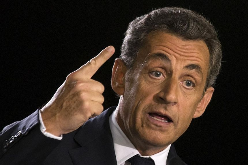 French former President Nicolas Sarkozy delivers a speech at a campaign rally for the leadership of the UMP political party in Paris on Nov 7, 2014. France's former president Nicolas Sarkozy was on Saturday tipped to win the leadership of his ri