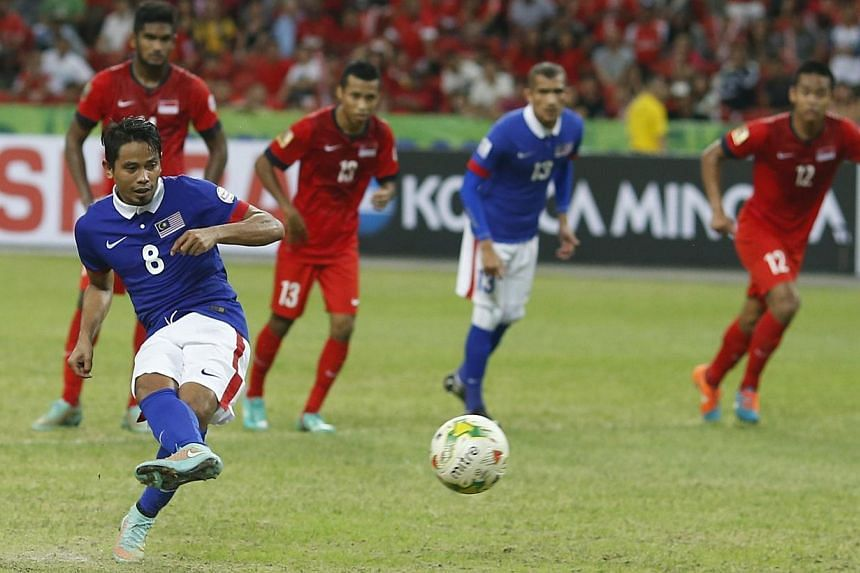 Malaysia's Safiq Bin Rahim converts a penalty to score against Singapore during their Suzuki Cup Group B match at the National Stadium in Singapore on Nov 29, 2014. -- PHOTO: REUTERS