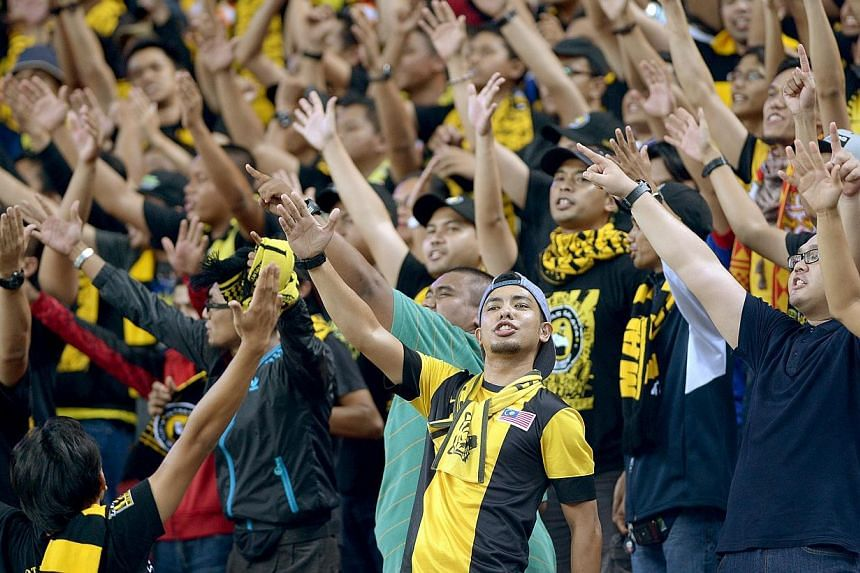 Malaysia fans at the National Stadium in Singapore during the AFF Suzuki 2014 Cup on Nov 29, 2014.  -- ST PHOTO: LIM SIN THAI