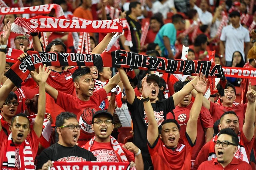 Singapore supporters attend a football match against Malaysia during the AFF Suzuki 2014 Cup at the National stadium in Singapore on Nov 29, 2014. -- PHOTO: AFP