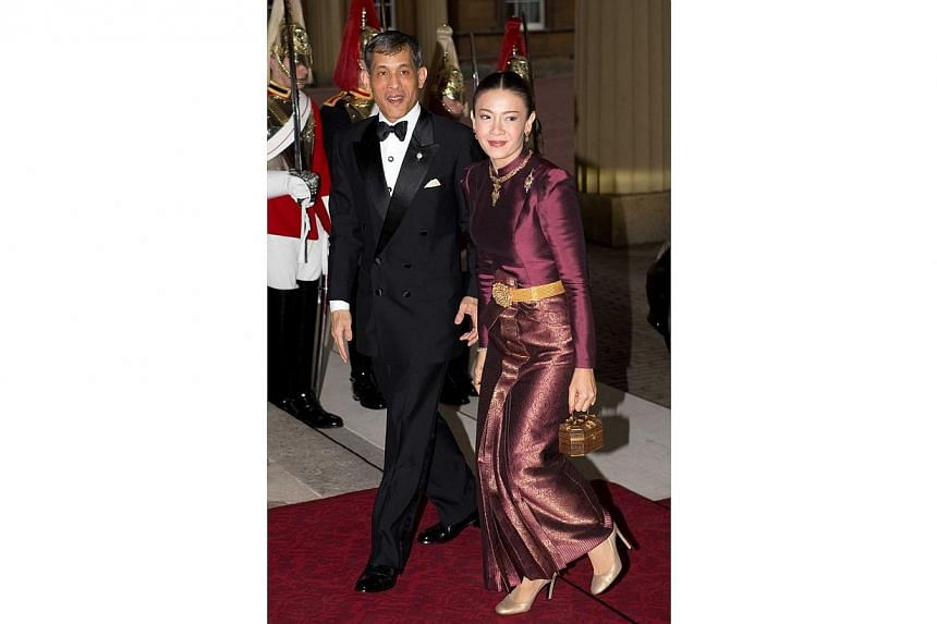 Crown Prince Maha Vajiralongkorn of Thailand and his wife, Princess Srirasmi, attend a dinner for foreign sovereigns hosted by the Prince of Wales and the Duchess of Cornwall at Buckingham Palace on May 18 2012. -- PHOTO: SNAPPER MEDIA