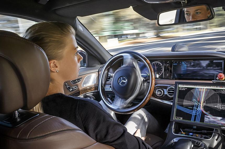 A simulated cabin of a future driverless car (left) and the autonomous Mercedes-Benz S500 Intelligent Drive (below left).