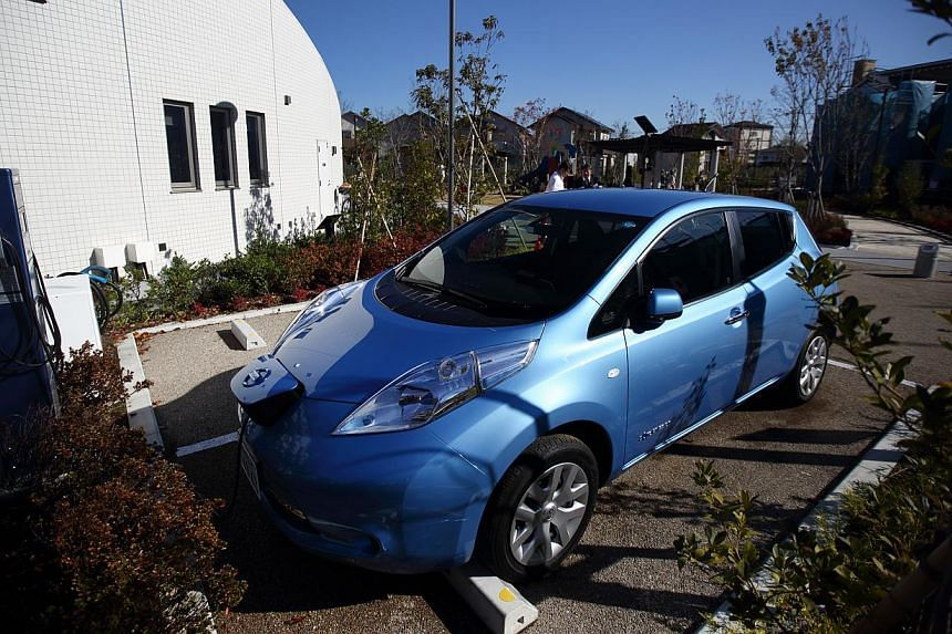 A Nissan Leaf electric vehicle (above) is used for a car-sharing service in Kanagawa Prefecture in Japan. In Singapore, there are car-sharing schemes such as Car Club. -- PHOTO: BLOOMBERG