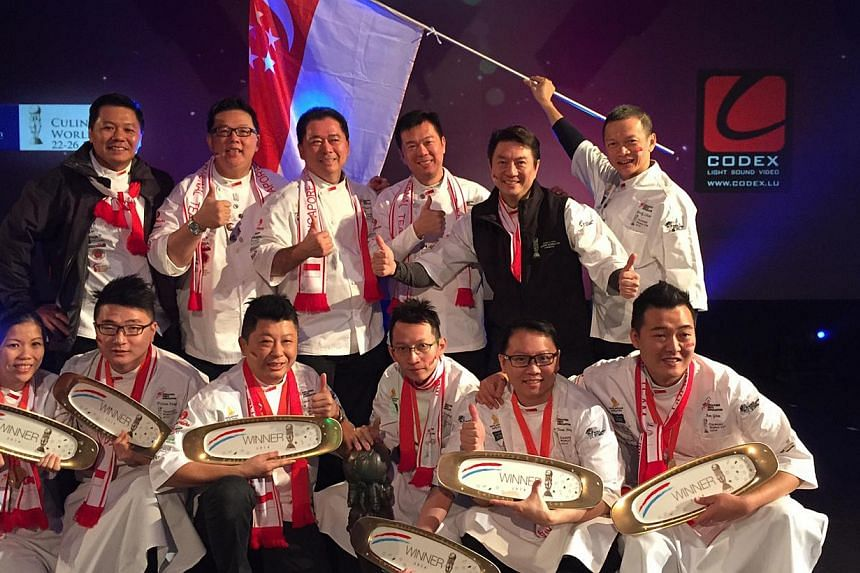Winning Team Singapore: (front row, from left) Chefs Ivy Wong, Triston Fang, Louis Tay, Yew Eng Tong, Teo Yeow Siang and Jim Gim and their mentors (back row, from left) Khoo Wee Bin, Eric Low, Edmund Toh, Anderson Ho, Eric Teo and Randy Chow. -- PHOT