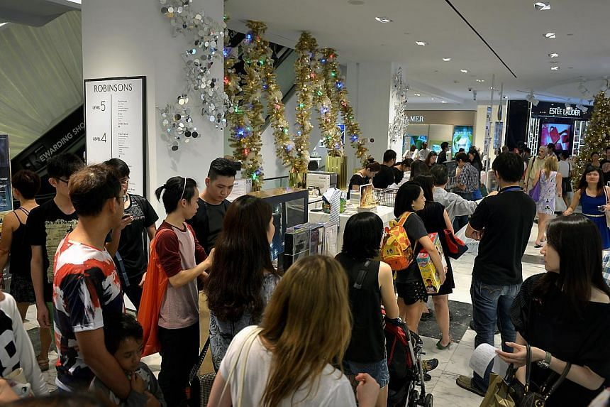 Crowds of shoppers at Robinsons The Heeren in Orchard Road yesterday. Robinsons said it saw four times more sales yesterday than the same day last year.