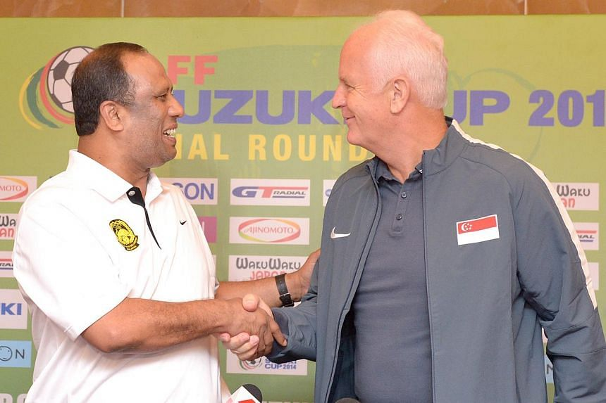 Malaysia coach Dollah Salleh (left) and Singapore coach Bernd Stange at Suzuki Cup press conference, Nov 28, 2014. -- ST PHOTO:LIM SIN THAI