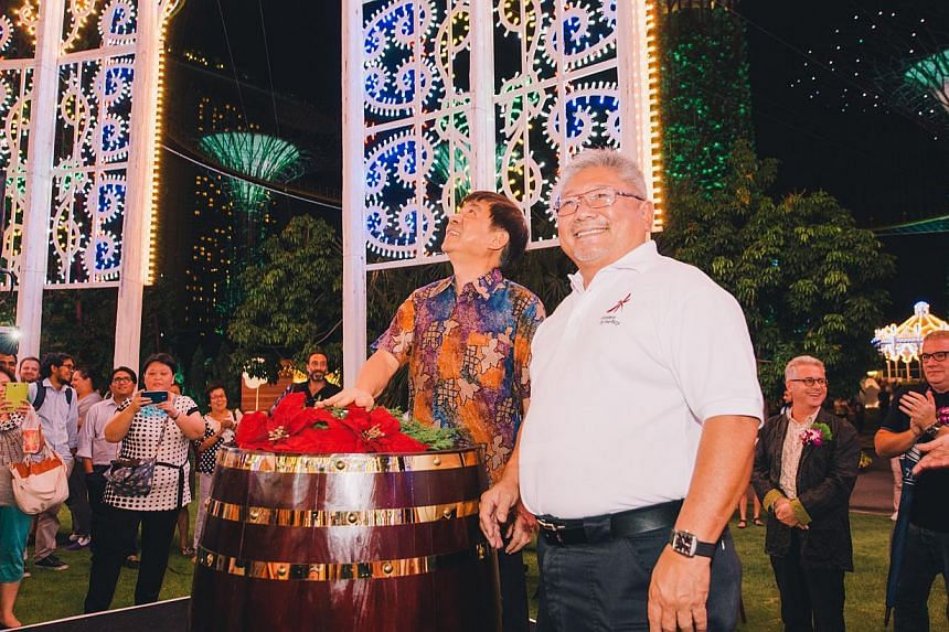 Minister for National Development Khaw Boon Wan (left) and Gardens by the Bay chief executive Kiat W. Tan lighting up the Spalliera, the largest Luminarie light structure at Christmas Wonderland @ Gardens by the Bay.-- PHOTO: CHRISTMAS WONDERLA