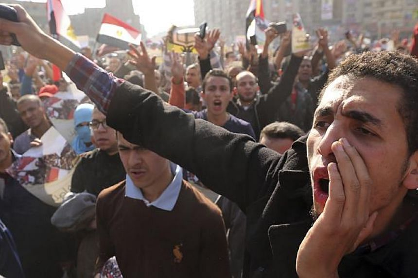 Supporters of the Muslim Brotherhood and ousted Egyptian President Mohamed Morsi shout slogans against the military and the interior ministry during a protest in Cairo Nov 28, 2014.Two people were killed on Friday when Islamist protesters and p