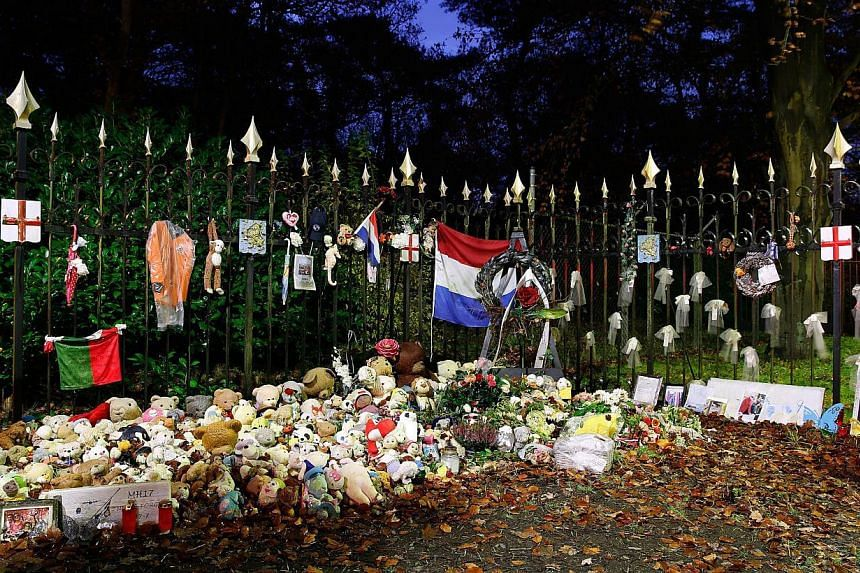 A picture taken on Nov 28 2014 shows flowers and stuffed animals layed outside the Van Oudheusdenkazerne military barracks in Hilversum in the Netherlands. Six more coffins carrying body parts of victims from downed Malaysia Airlines Flight MH17 arri