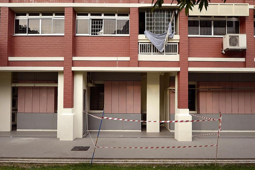 An inspection by HDB officers of the Elias Road flat found damage on two walls. One damaged area was about the size of a basketball. -- ST PHOTO:LIM SIN THAI