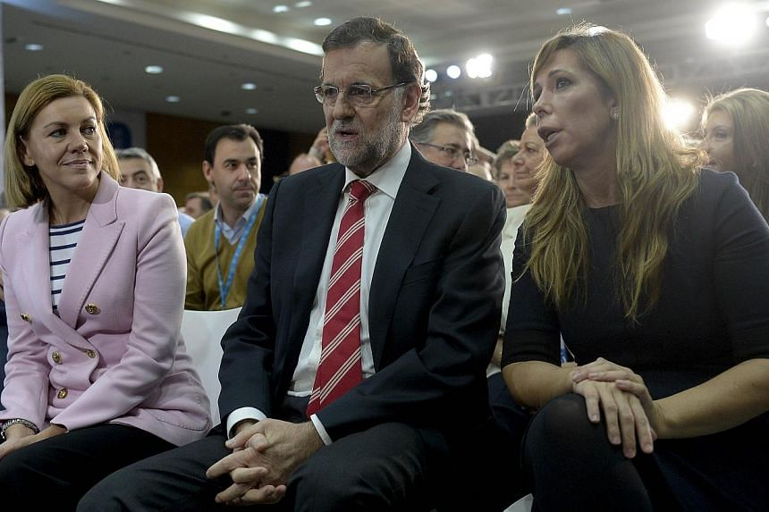 Spanish Prime Minister and Popular Party (PP) leader Mariano Rajoy (centre), PP general secretary Maria Dolores de Cospedal (left) and PP in Catalonia president Alicia Sanchez Camacho attend a conference of the PP on political stability and good gove