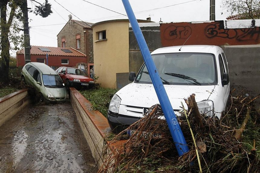 Cars are damaged after the river Massane flooded the city of Argeles-sur-Mer, southern France, due to heavy rains on Nov 30, 2014. -- PHOTO: AFP