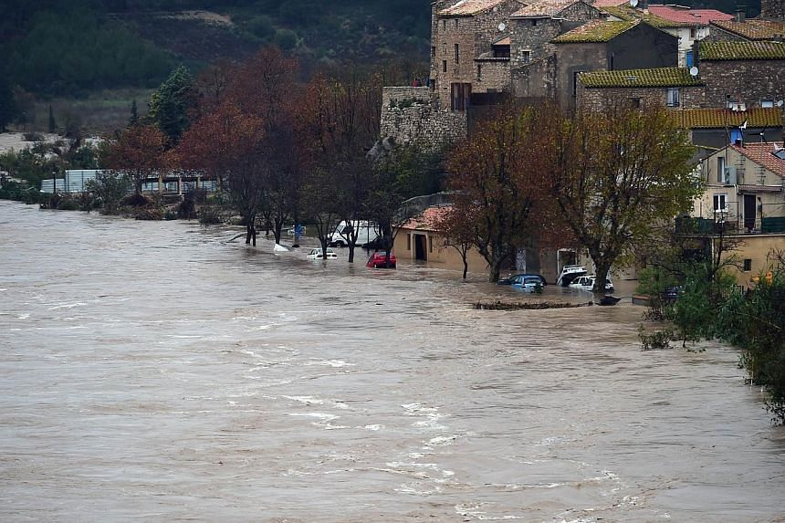 A photo shows the swollen river La Berre in the flooded city of Portel-des-Corbieres, southern France, following heavy rains on Nov 30, 2014. -- PHOTO: AFP
