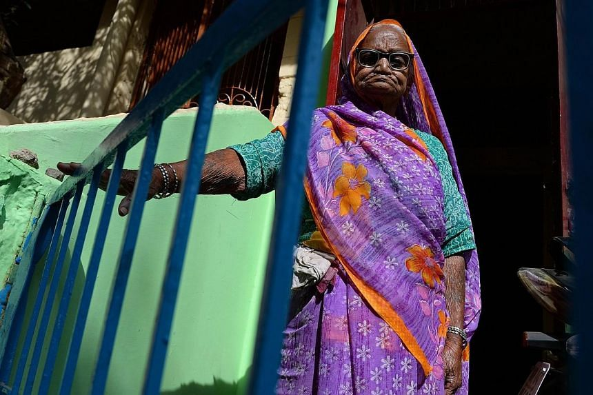 Bhopal gas disaster survivor Rampyari Bai, 90, now nearly deaf and riddled with cancer and ulcers, insists she will never give up fighting for justice for victims of the world's worst industrial disaster. -- PHOTO: AFP