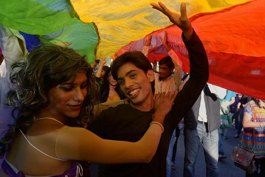 Indian members and supporters of the lesbian, gay, bisexual, transgender (LGBT) community dance during a Gay Pride Parade in New Delhi on Nov 30,2014.Hundreds of gays and lesbians marched through the streets of the Indian capital on Sunday, the