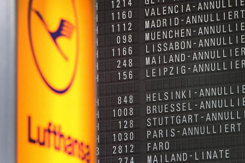 A display showing cancelled flights due to a strike of pilots of German airline Lufthansa is pictured at the airport in Frankfurt am Main, western Germany, on Oct 21, 2014. A leading German pilots' union has called a fresh walkout at Lufthansa s