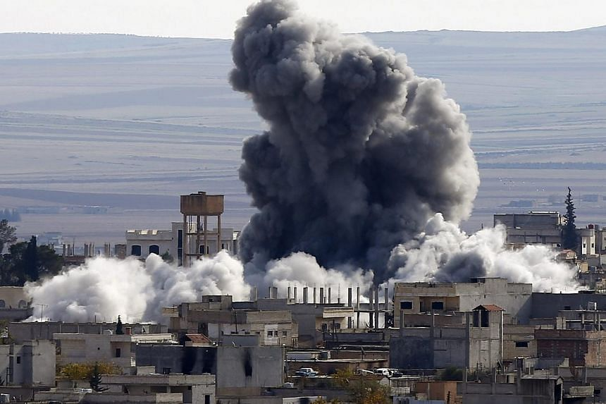 An explosion following an air strike is seen in western Kobane neighbourhood, on Nov 23, 2014. At least 50 extremists of the Islamic State in Iraq and Syria (ISIS) have been killed in the past 24 hours in clashes, suicide bombings and US-led air