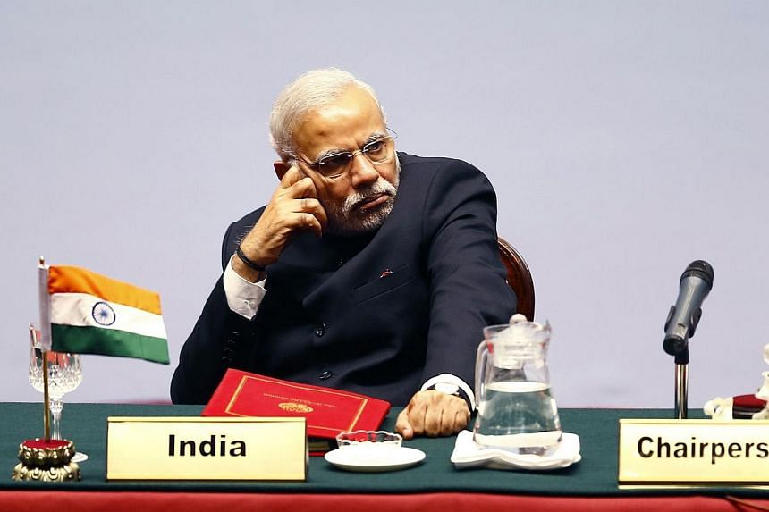 In this photograph taken on Novr 26, 2014, the Prime Minister of India Narendra Modi looks on during the opening session of the 18th South Asian Association for Regional Cooperation (SAARC) summit in the Nepalese capital Kathmandu. -- PHOTO: AFP
