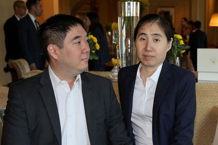 Matthew and Grace Huang, a US couple who were sentenced to three years in jail in Qatar in April 2014 for allegedly causing the death of their adopted daughter Gloria, were acquitted on Sunday by a Qatari court. -- PHOTO: AFP