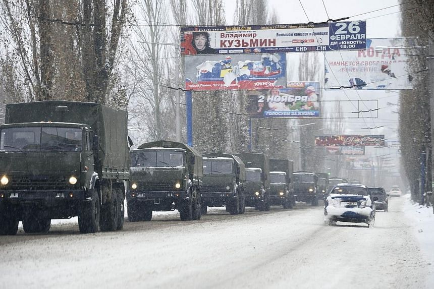 A military convoy of about 30 trucks without license plates moves on Nov 30, 2014 on an avenue in the eastern city of Donetsk controlled by pro-Russian rebels.Ukraine said on Sunday that a convoy of 106 vehicles had entered its eastern territor