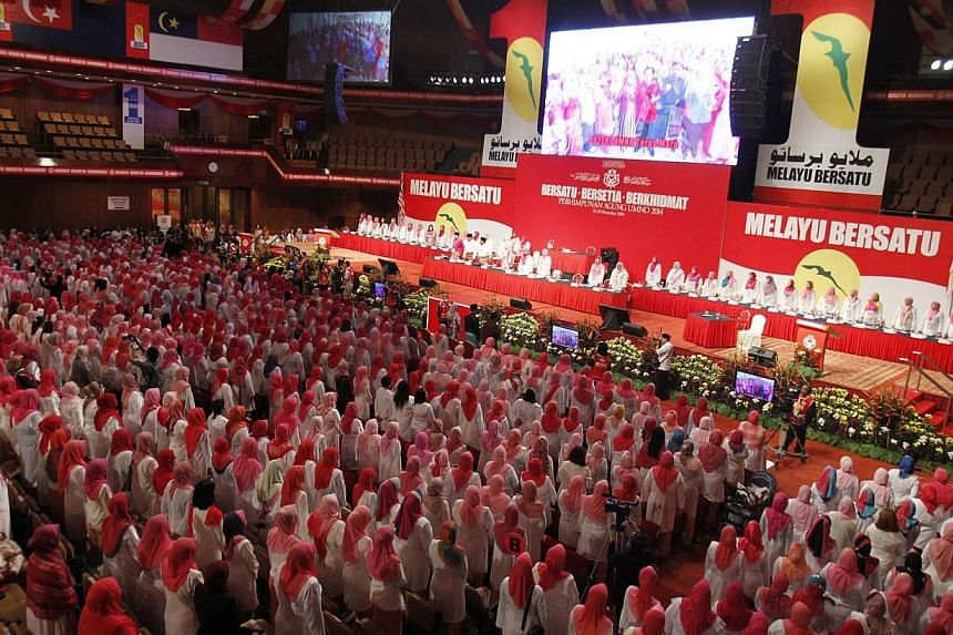 Delegates at Malaysia's Umno general assembly in Kuala Lumpur watched in pin-drop silence as a short video clip of a beheading by Islamic State in Iraq and Syria (ISIS) militants was aired. -- PHOTO: SIN CHEW DAILY PUBLICATION