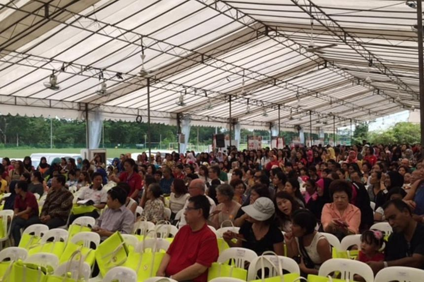 Some 5,000 foreign domestic workers gather at the Grandstand for the annual Foreign Domestic Worker Day, organised by non-governmental group FAST. -- ST PHOTO: AUDREY TAN