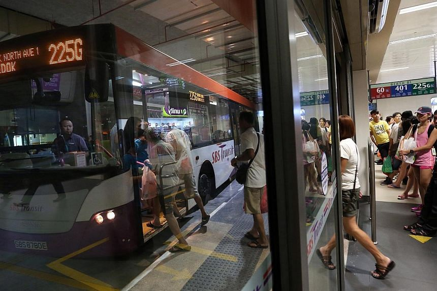 Commuters waiting for buses at the new Bedok Integrated Transport Hub, which links Bedok MRT, Bedok Mall and the bus interchange, on Sunday, Nov 30.-- ST PHOTO: NEO XIAOBIN