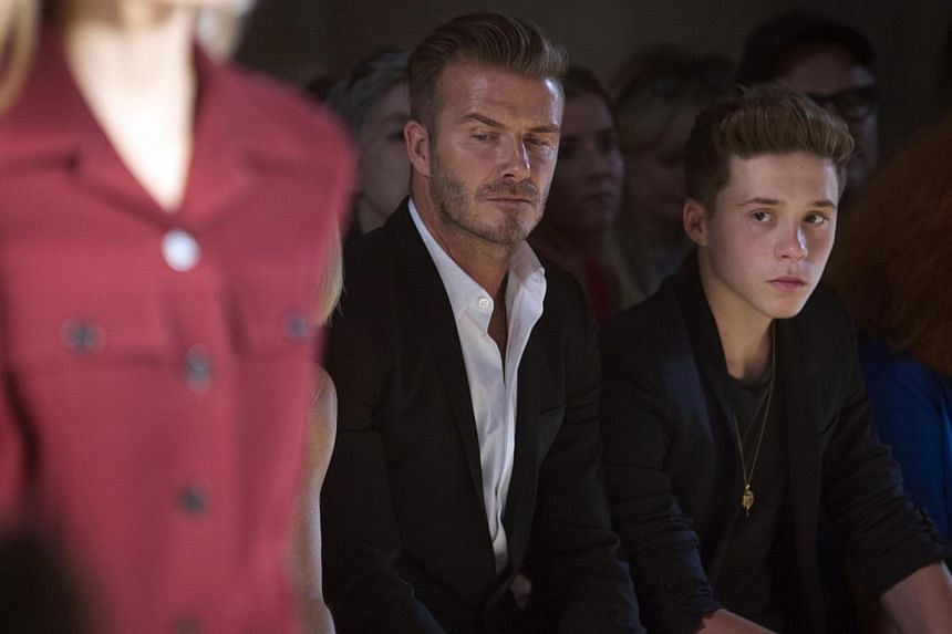 Retired English football star David Beckham and his teenage son Brooklyn were involved in a car crash outside Arsenal's training ground in Hertfordshire, north of London, but did not suffer any injuries, according to a source close to Beckham. -- PHO