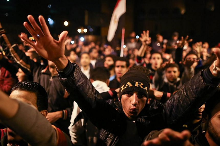 Egyptian anti-Mubarak protesters chant slogans as they gather in Abdel Moneim Riad Square in Cairo on Nov 29, 2014. -- PHOTO: AFP