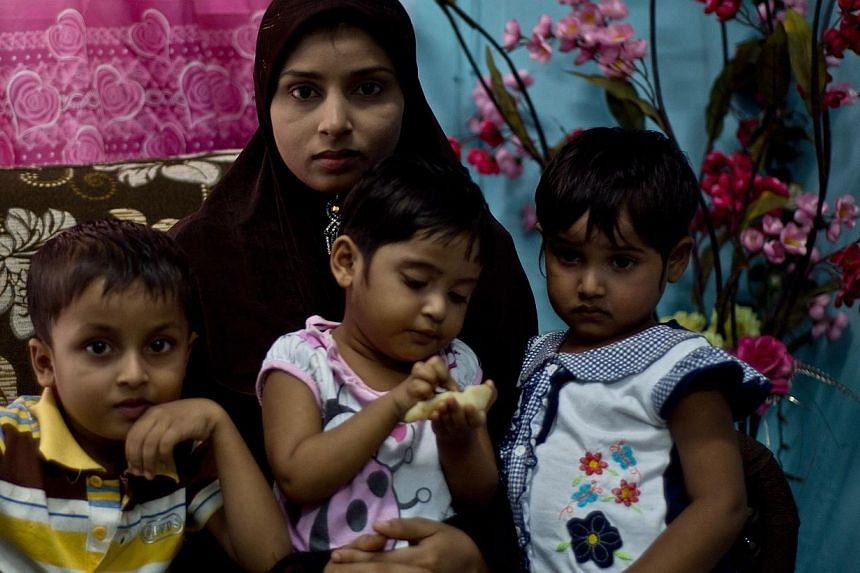 Ms Bibijan Rahimullah and her three young children endured a harrowing, month-long odyssey by sea and land to Malaysia. -- PHOTO: AFP