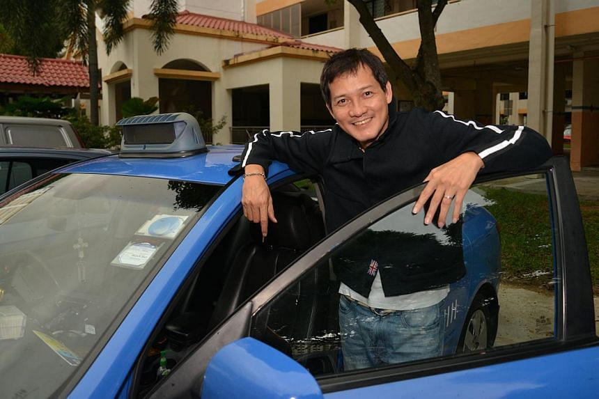 Earnings from his job as a taxi driver are helping Peter Yu to service his gambling debts chalked up after his divorce from TV host Quan Yifeng. --ST PHOTO: BENSON ANG