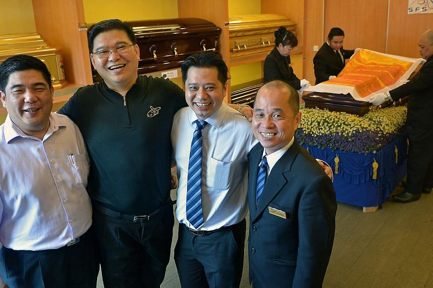 The team from Life Corporation, which includes (from left) executive directors Kenneth Lim and Victor Hoo, chief executive officer Simon Hoo and business development manager Dennis Wong. -- ST PHOTO: KUA CHEE SIONG