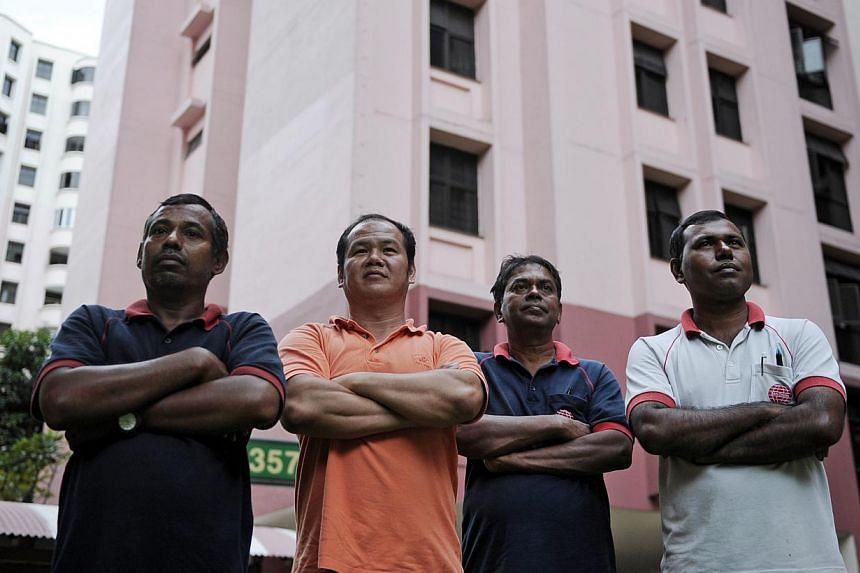 Conservancy worker Mokter Hossen Rahman Howlader, 32; supervisor Lim Kok, 44; conservancy worker Mohammedin Saghir Ahmad, 54; and foreman Sadek Abdul Gafur, 36, each cover two blocks and assist citizen patrol groups.