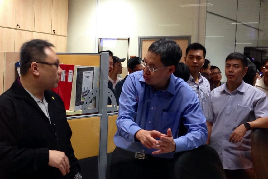 Transport Minister Lui Tuck Yew interacting with staff of the new Bedok Integrated Transport Hub on Sunday, Nov 30.-- ST PHOTO: YEO SAM JO