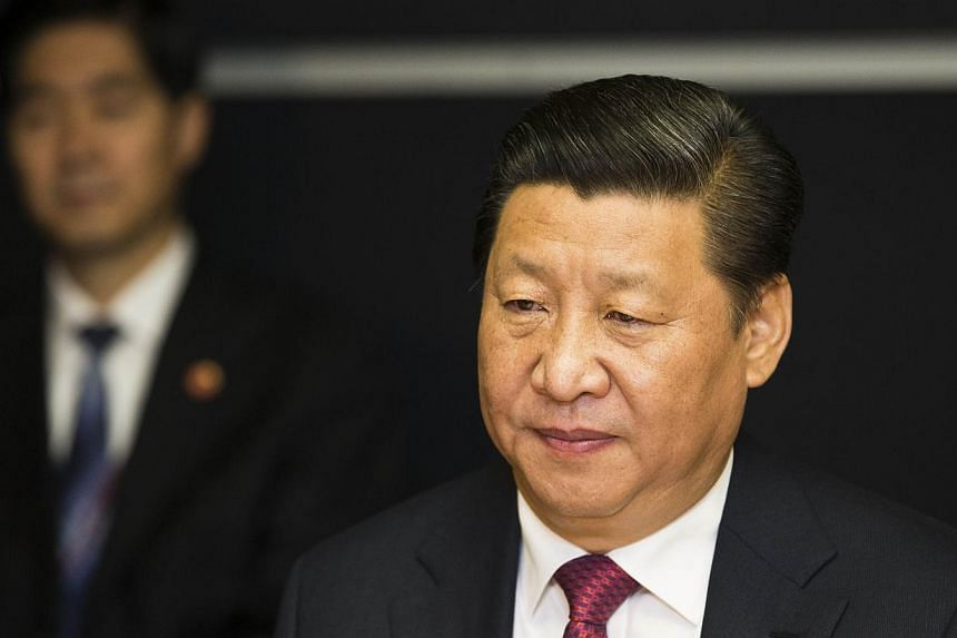 """We should firmly uphold China's territorial sovereignty, maritime rights and interests and national unity,"" Mr Xi told a Communist Party meeting on foreign affairs held on Friday and Saturday. -- PHOTO: AFP"