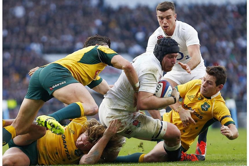 Ben Morgan of England scores a try against Australia during their international rugby test match at Twickenham Stadium in London, Nov 29, 2014.-- PHOTO: REUTERS