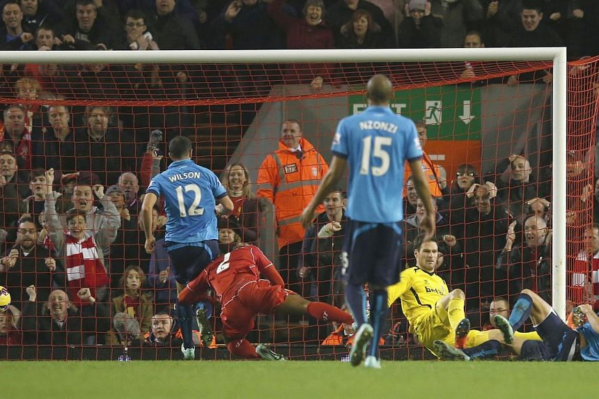 Liverpool's Glen Johnson (second left) scores a goal against Stoke City during their English Premier League soccer match at Anfield in Liverpool, northern England Nov 29, 2014. -- PHOTO: REUTERS