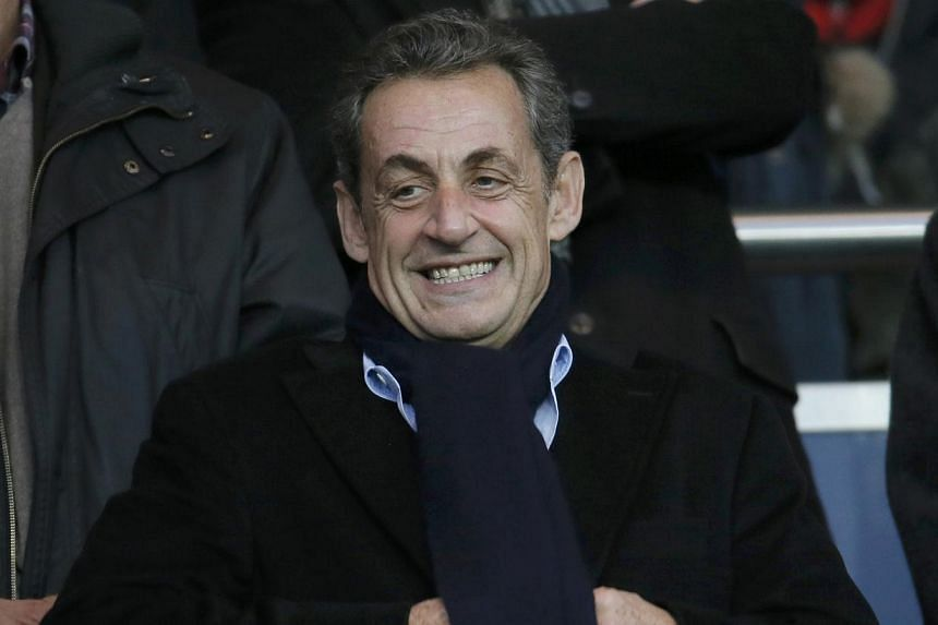 Former French president Nicolas Sarkozy attends the French Ligue 1 soccer match between Paris St Germain and Nice at the Parc des Princes Stadium in Paris Nov 29, 2014. Bruised by a humiliating election loss and ensnared in a tangle of legal woes, wh