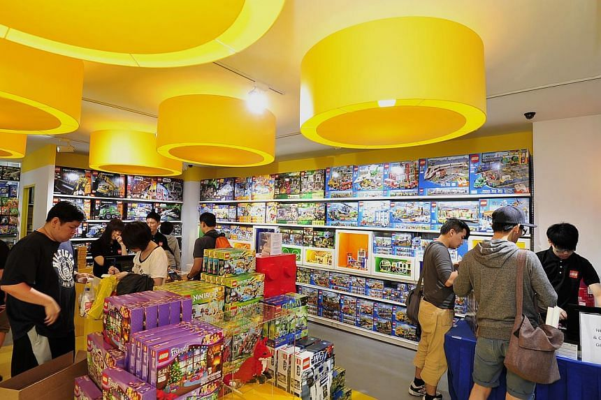 Customers at the LEGO certified store. -- ST PHOTO: DIOS VINCOY JR
